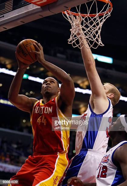 Chuck Hayes of the Houston Rockets drives to the basket while being defended by Chris Kaman of the Los Angeles Clippers in the first half at Staples...