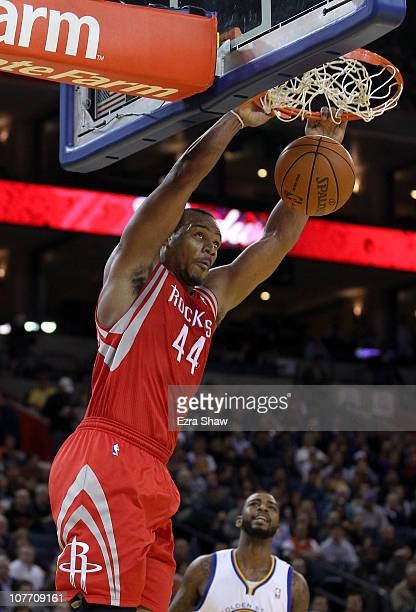Chuck Hayes of the Houston Rockets dunks the ball during their game against the Golden State Warriors at Oracle Arena on December 20 2010 in Oakland...