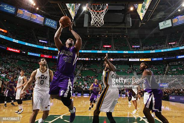 Chuck Hayes of the Sacramento Kings drives to the basket against Enes Kanter and Jeremy Evans of the Utah Jazz at EnergySolutions Arena on December...