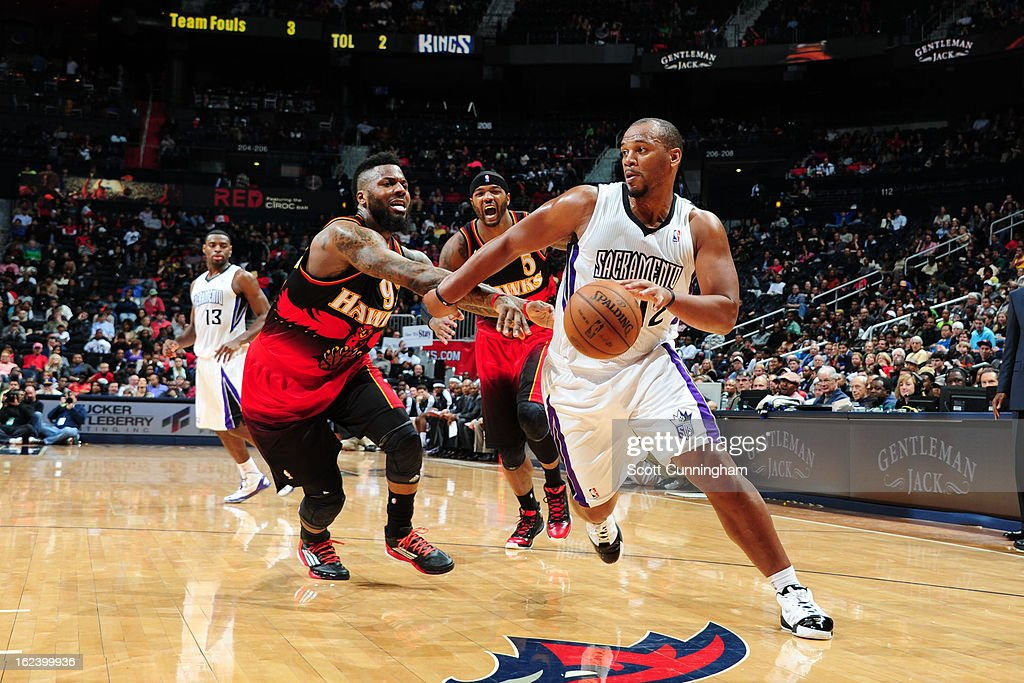 Chuck Hayes #42 of the Sacramento Kings drives to the basket against DeShawn Stevenson #92 of the Atlanta Hawks on February 22, 2013 at Philips Arena in Atlanta, Georgia.