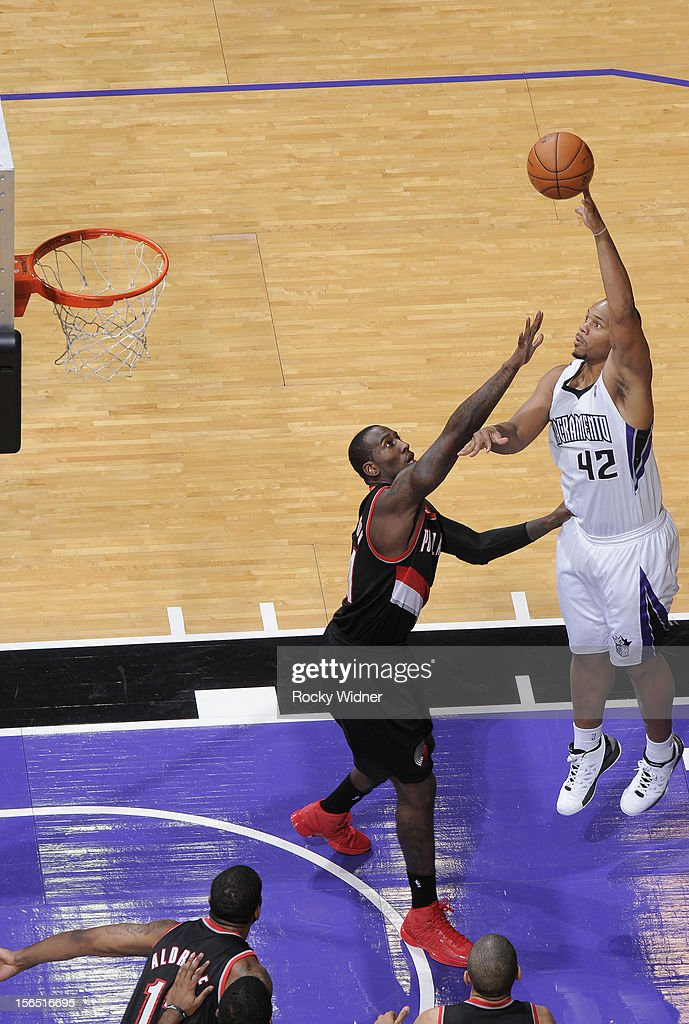 <a gi-track='captionPersonalityLinkClicked' href=/galleries/search?phrase=Chuck+Hayes&family=editorial&specificpeople=206129 ng-click='$event.stopPropagation()'>Chuck Hayes</a> #42 of the Sacramento Kings puts up a shot over <a gi-track='captionPersonalityLinkClicked' href=/galleries/search?phrase=J.J.+Hickson&family=editorial&specificpeople=4226173 ng-click='$event.stopPropagation()'>J.J. Hickson</a> #21 of the Portland Trail Blazers on November 13, 2012 at Sleep Train Arena in Sacramento, California.