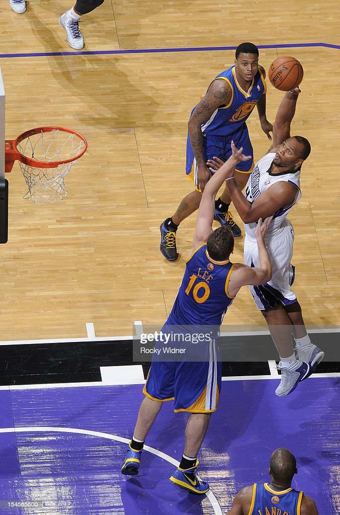 Chuck Hayes #42 of the Sacramento Kings shoots a hook shot over David Lee #10 of the Golden State Warriors on October 17, 2012 at Power Balance Pavilion in Sacramento, California.
