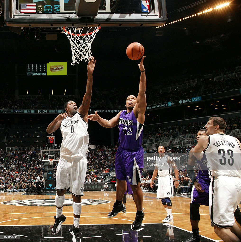 Chuck Hayes #42 of the Sacramento Kings shoots against Andray Blatche #0 of the Brooklyn Nets on January 5, 2013 at the Barclays Center in the Brooklyn borough of New York City.
