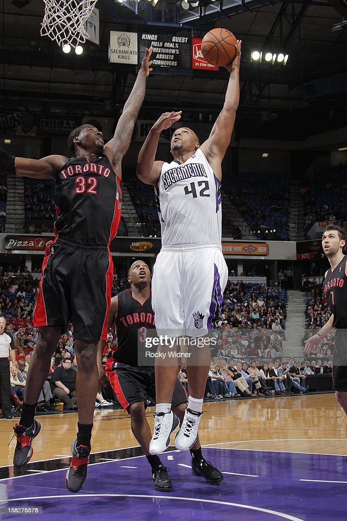 <a gi-track='captionPersonalityLinkClicked' href=/galleries/search?phrase=Chuck+Hayes&family=editorial&specificpeople=206129 ng-click='$event.stopPropagation()'>Chuck Hayes</a> #42 of the Sacramento Kings shoots over Ed Davis #32 of the Toronto Raptors on December 5, 2012 at Sleep Train Arena in Sacramento, California.