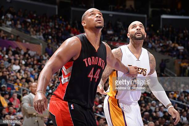 Chuck Hayes of the Toronto Raptors battles for position against Carlos Boozer of the Los Angeles Lakers at STAPLES Center on November 30 2014 in Los...