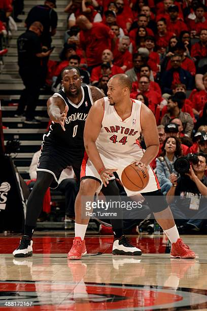 Chuck Hayes of the Toronto Raptors handles the ball against Andray Blatche of the Brooklyn Nets in Game Seven of the Eastern Conference Quarterfinals...