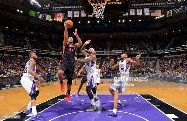 Chuck Hayes of the Toronto Raptors shoots a layup against DeMarcus Cousins of the Sacramento Kings on February 5 2014 at Sleep Train Arena in...