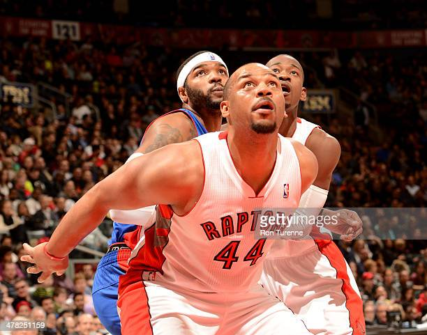 Chuck Hayes of the Toronto Raptors waits for a rebound against the Detroit Pistons on March 12 2014 at the Air Canada Centre in Toronto Ontario...