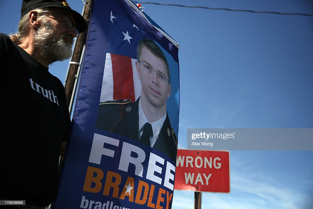 Chuck Heyn of Veterans for Peace, a supporter of U.S. Army Pfc. Bradley E. Manning, holds a sign to show support during a demonstration outside the main gate of Ft. Meade July 30, 2013 in Maryland. Military Judge Col. Denise Lind, who is presiding in the case of United States vs. Pfc. Bradley E. Manning, has reached a verdict and she is scheduled to read the verdict at 1pm today. Manning could face a life sentence for charges of espionage, aiding the enemy and computer fraud, for passing classified documents to WikiLeaks.