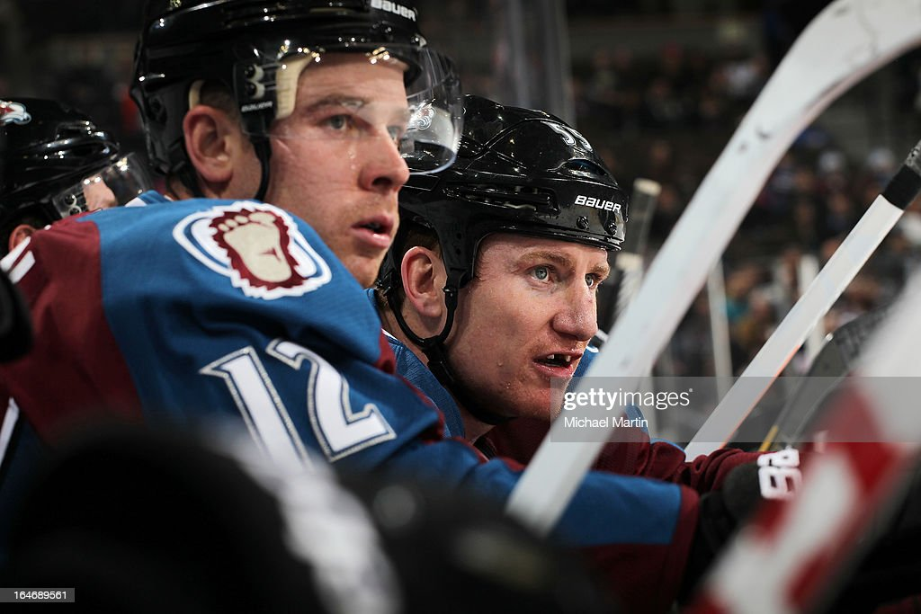 Chuck Kobasew and Cody McLeod of the Colorado Avalanche sit on the bench during the game against the Vancouver Canucks at the Pepsi Center on March...