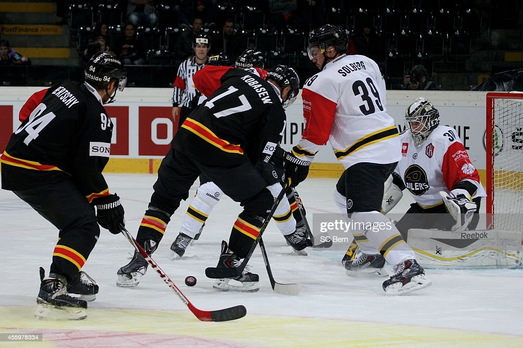 Chuck Kobasew of Bern and Henrik Solberg and Ruben Smith of Stavanger battle for the puck during the Champions Hockey League group stage game between...