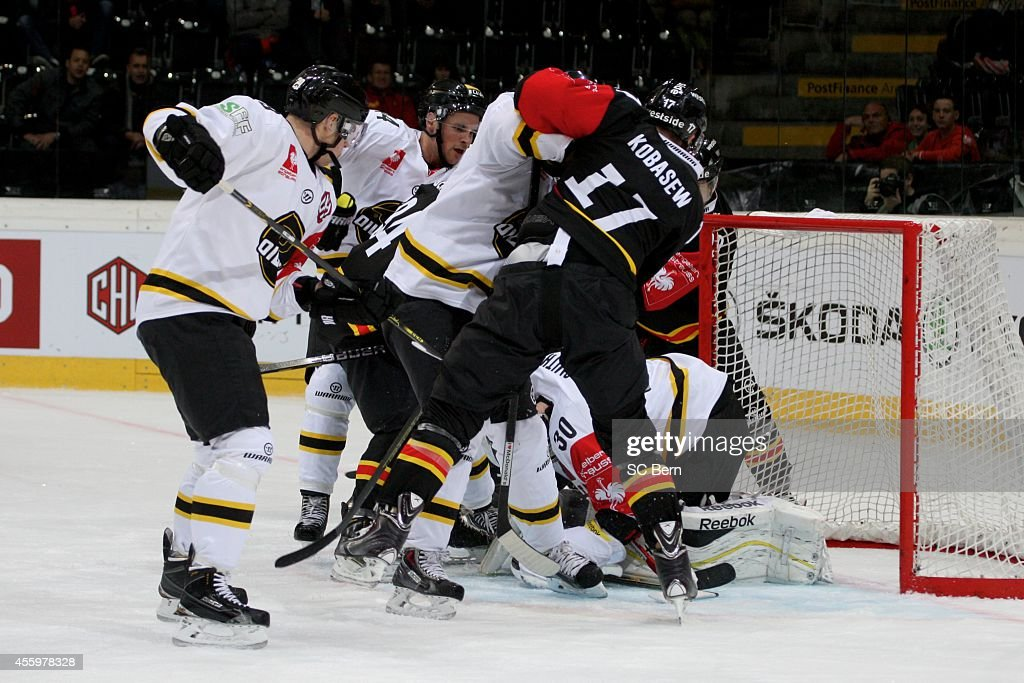 Chuck Kobasew of Bern and Ruben Smith of Stavanger battle for the puck during the Champions Hockey League group stage game between SC Bern and...