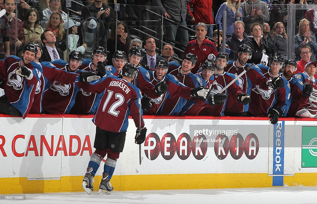 Chuck Kobasew of the Colorado Avalanche celebrates the gamewinning goal with teammates against the Dallas Stars at the Pepsi Center on March 20 2013...