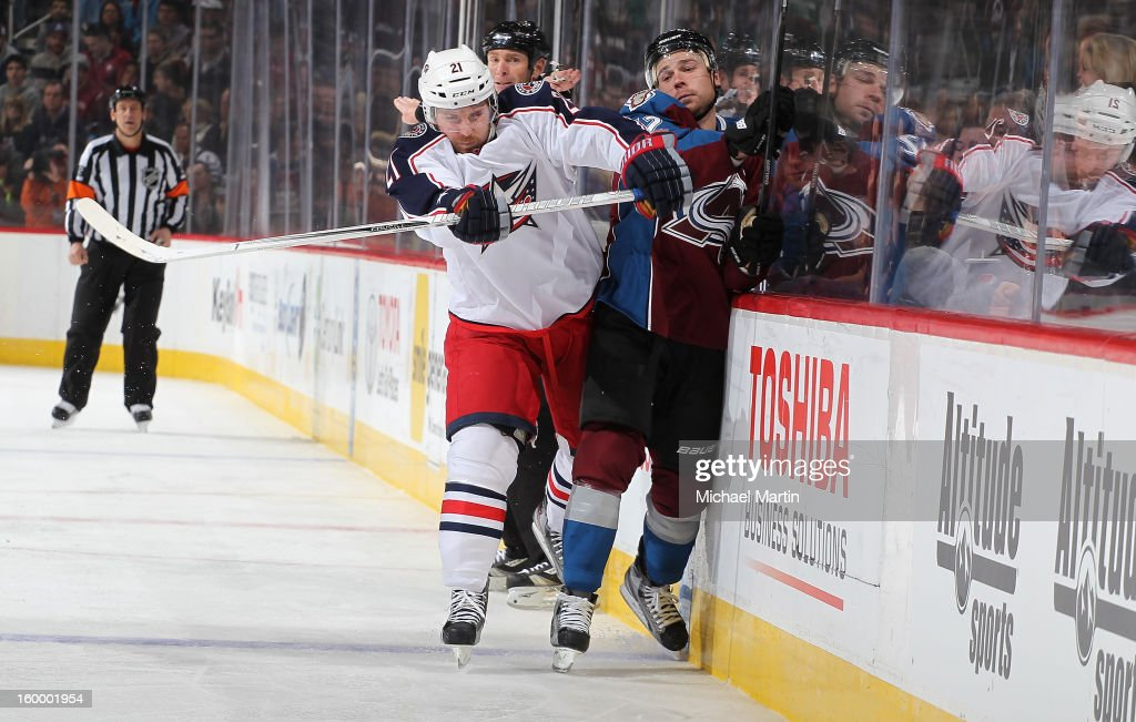 <a gi-track='captionPersonalityLinkClicked' href=/galleries/search?phrase=Chuck+Kobasew&family=editorial&specificpeople=208995 ng-click='$event.stopPropagation()'>Chuck Kobasew</a> #12 of the Colorado Avalanche is checked into the boards by <a gi-track='captionPersonalityLinkClicked' href=/galleries/search?phrase=James+Wisniewski&family=editorial&specificpeople=688111 ng-click='$event.stopPropagation()'>James Wisniewski</a> #21 of the Columbus Blue Jackets at the Pepsi Center on January 24, 2013 in Denver, Colorado. Colorado beat Columbus 4-0.