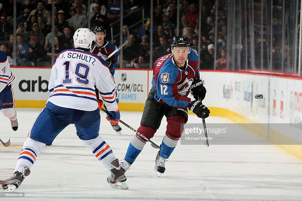 <a gi-track='captionPersonalityLinkClicked' href=/galleries/search?phrase=Chuck+Kobasew&family=editorial&specificpeople=208995 ng-click='$event.stopPropagation()'>Chuck Kobasew</a> #12 of the Colorado Avalanche passes the puck into the corner as Justin Schultz #19 of the Edmonton Oilers defends at the Pepsi Center on February 2, 2013 in Denver, Colorado.