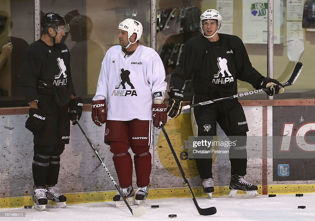 Chuck Kobasew #17 of the Colorado Avalanche, Steve Sullivan of the Phoenix Coyotes and Sidney Crosby #87 of the Pittsburgh Penguins participate in a workout at the Ice Den on December 3, 2012 in Scottsdale, Arizona. More than a dozen players from around the league that are not able to play during the NHL lockout have been attending workouts at the Phoenix Coyotes practice rink.
