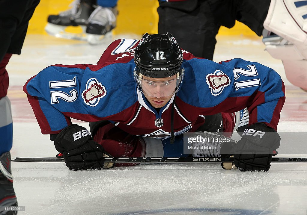 Chuck Kobasew of the Colorado Avalanche stretches against the Chicago Blackhawks at the Pepsi Center on March 18 2013 in Denver Colorado