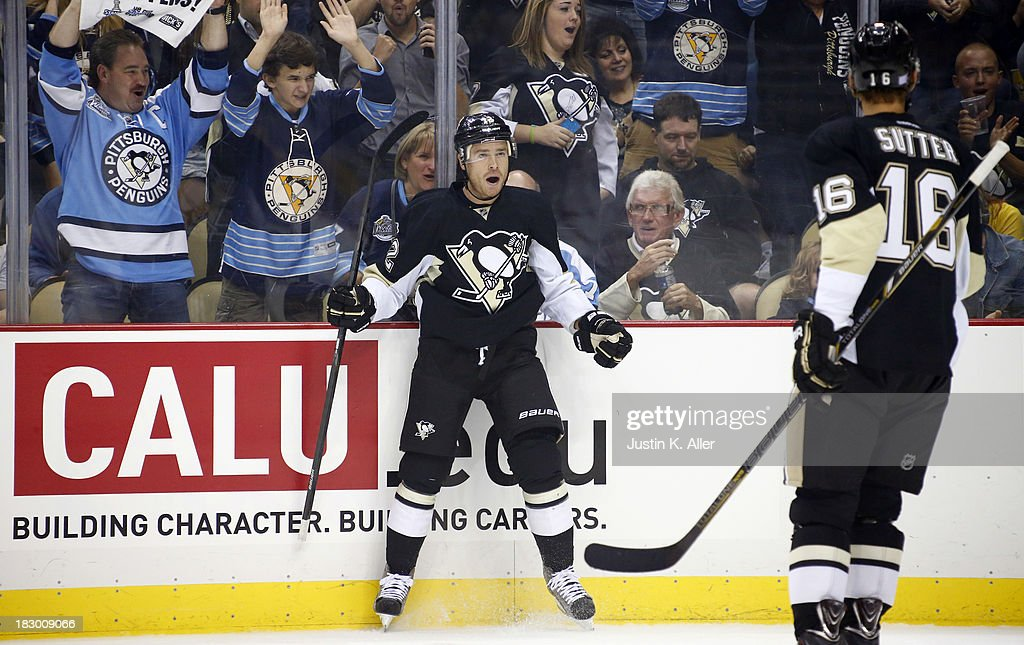 Chuck Kobasew of the Pittsburgh Penguins celebrates his firstperiod goal against the New Jersey Devils during the home opener at Consol Energy Center...