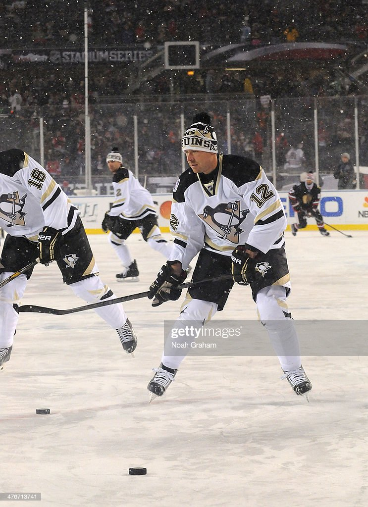 Chuck Kobasew of the Pittsburgh Penguins skates during warmup prior to the 2014 NHL Stadium Series game at Soldier Field on March 1 2014 in Chicago...
