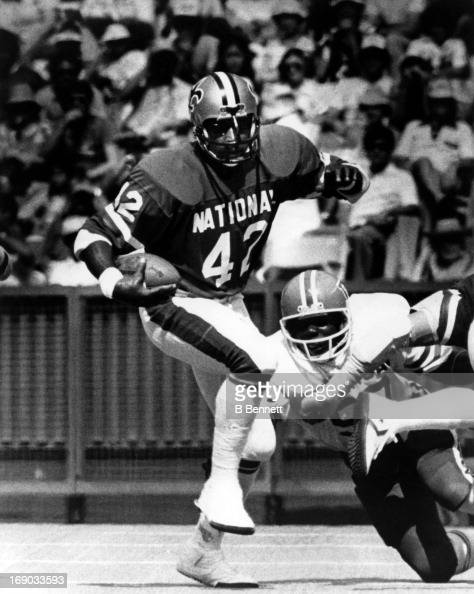 Chuck Muncie of the New Orleans Saints and National Football Conference runs with the ball during the 1980 Pro Bowl against the American Football...