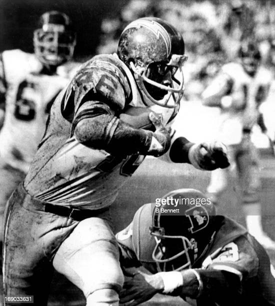 Chuck Muncie of the San Diego Chargers avoids being tackled by Steve Foley of the Denver Broncos on November 29 1981 at Jack Murphy Stadium in San...