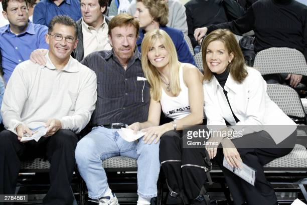 Chuck Norris with wife and friends at the Dallas Mavericks and the Los Angeles Lakers December 4 2003 at the American Airlines Center in Dallas Texas...