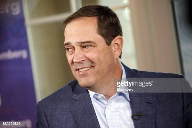 Chuck Robbins chief executive officer of Cisco Systems Inc smiles during a Bloomberg Television interview on the sidelines of the Wall Street Journal...