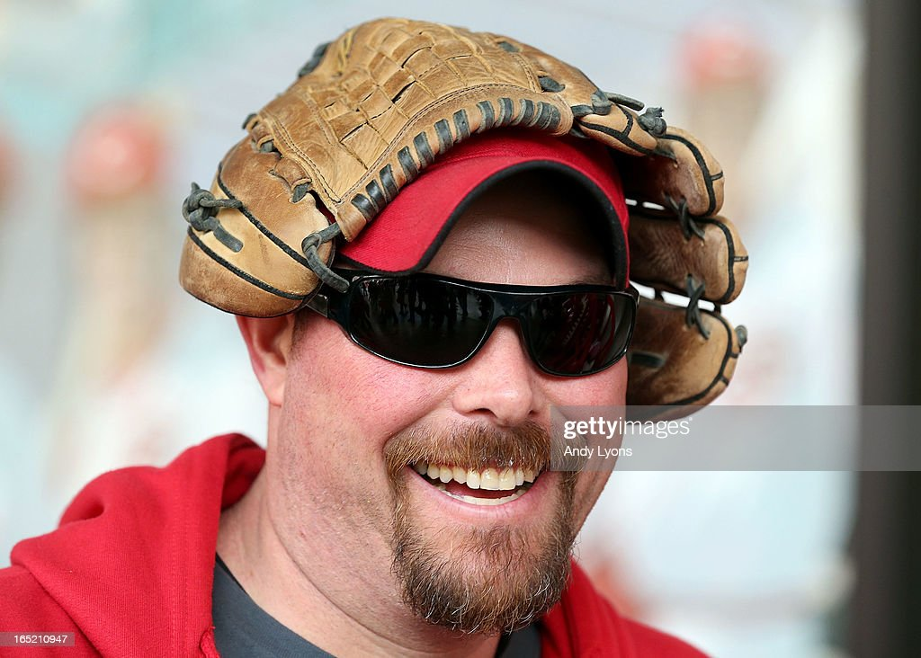 Chuck Venable wears his baseball golve on his head before the start of the Los Angeles Angels of Anaheim game against the Cincinnati Reds at Great American Ball Park on April 1, 2013 in Cincinnati, Ohio.