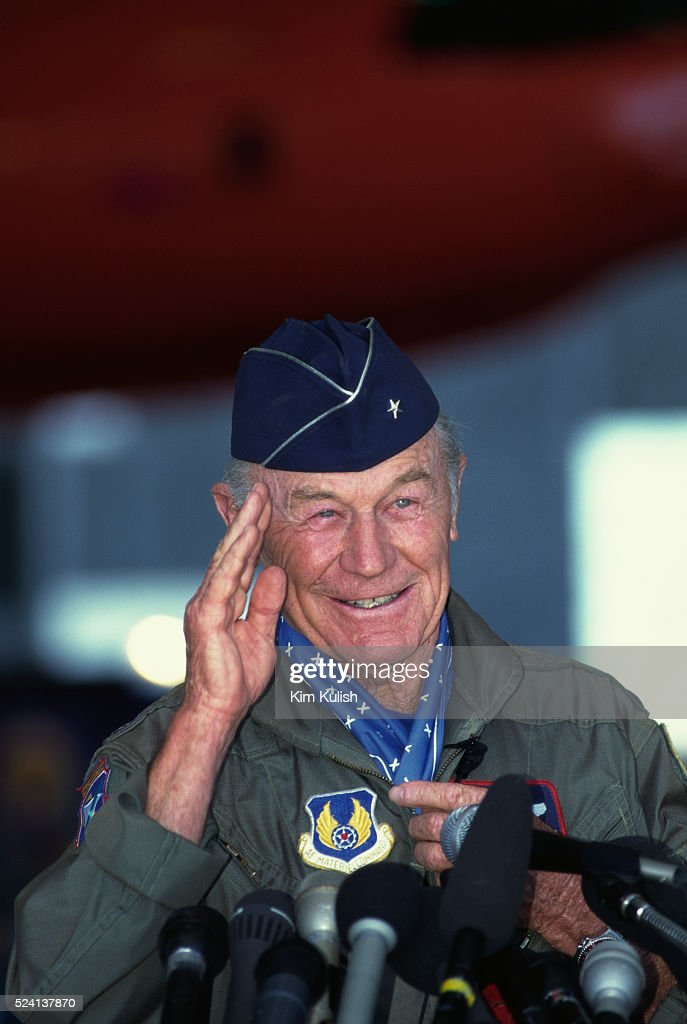 Chuck Yeager salutes during a press conference at Edwards Air Force Base during the 50th anniversary celebration of his October 14 1947 Bell X1...