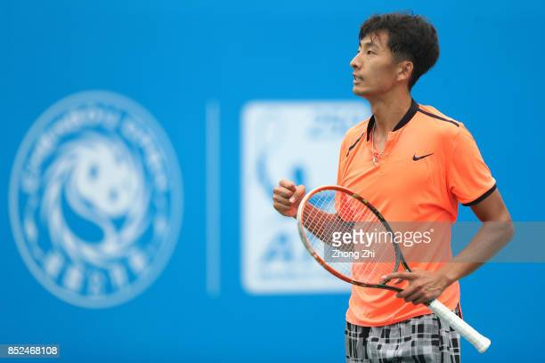 Chuhan Wang of China celebrates a point during the match against Jose Statham of New Zealand during Qualifying first round of 2017 ATP Chengdu Open...