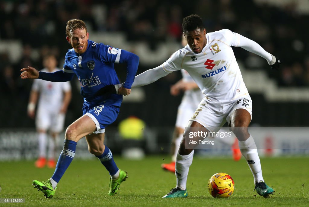 Chuks Aneke of MK Dons and Paul Green of Oldham Athletic in action during the Sky Bet League One match between Milton Keynes Dons and Oldham Athletic at StadiumMK on February 7, 2017 in Milton Keynes, England.