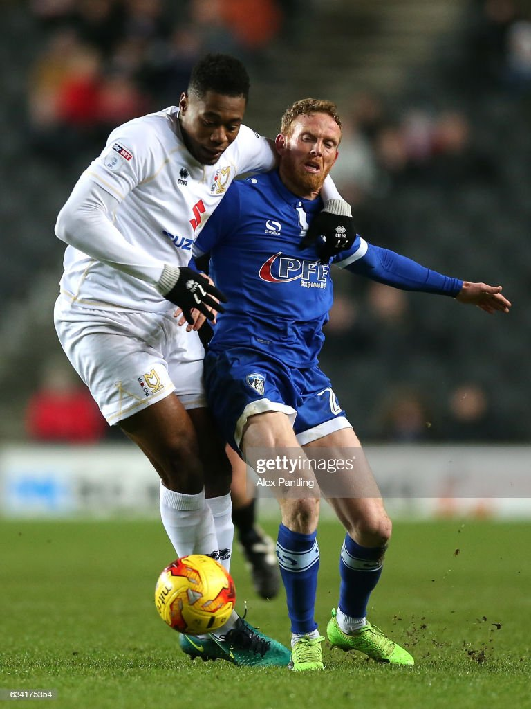 Chuks Aneke of MK Dons holds off Paul Green of Oldham Athletic during the Sky Bet League One match between Milton Keynes Dons and Oldham Athletic at StadiumMK on February 7, 2017 in Milton Keynes, England.