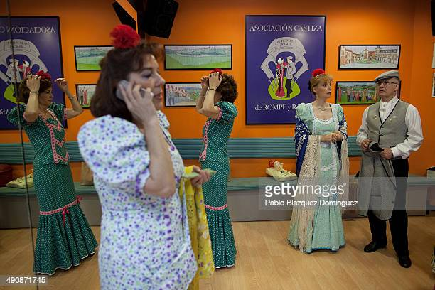 'Chulapas' prepare at the 'Association of Rompe y Rasga' premises during the San Isidro festivities before making their way to Pradera de San Isidro...