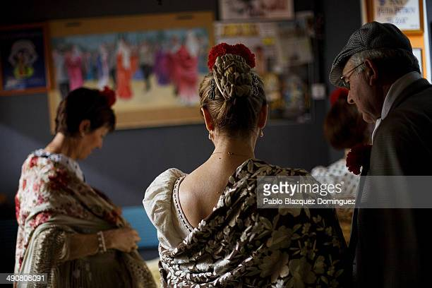 'Chulapos' prepare at the 'Association of Rompe y Rasga' premises during the San Isidro festivities before making their way to Pradera de San Isidro...