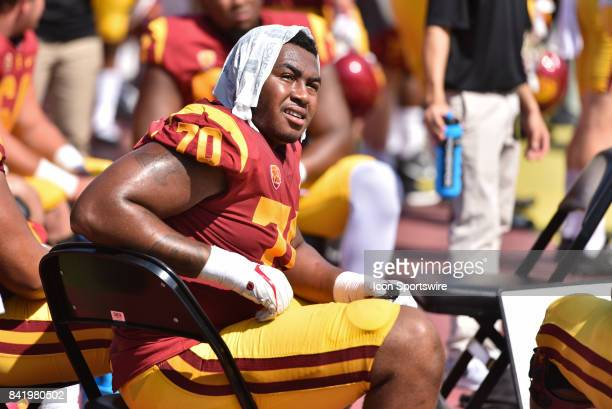 Chuma Edoga sits on the sidelines with a towel on his head during a college football game between the Western Michigan Broncos and the USC Trojans on...