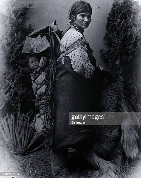 'Chuna' A Navajo woman carrying a baby in a cradle board Undated Photograph