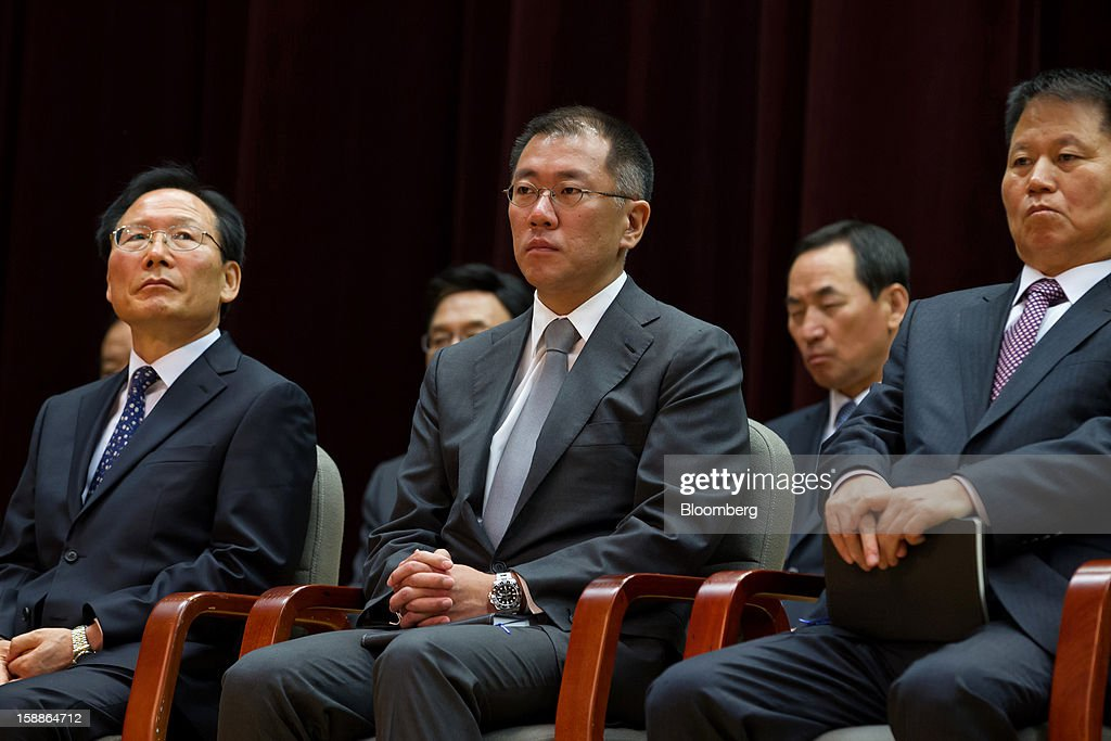 Chung Eui Sun, vice chairman of Hyundai Motor Co., front row center, attends a new year company meeting in Seoul, South Korea, on Wednesday, Jan. 2, 2013. Hyundai Motor and smaller affiliate Kia Motors, South Korea's two largest automakers, forecast their slowest sales growth in seven years as a slowing global economy and strengthening won saps demand. Photographer: SeongJoon Cho/Bloomberg via Getty Images