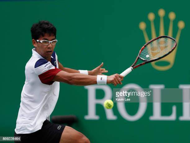 Chung Hyeon of Korea returns a shot to Roberto Bautista Agut of Spain during the First Round on Day 2 of 2017 ATP 1000 Shanghai Rolex Masters on...