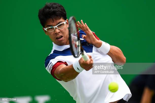 Chung Hyeon of South Korea hits a return during the men's singles against Roberto Bautista Agut of Spain at the Shanghai Masters in Shanghai on...