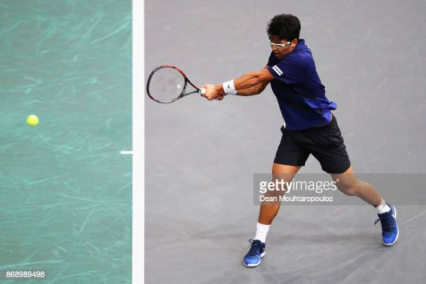 Chung Hyeon of South Korea returns a backhand against Rafael Nadal of Spain during Day 3 of the Rolex Paris Masters held at the AccorHotels Arena on...