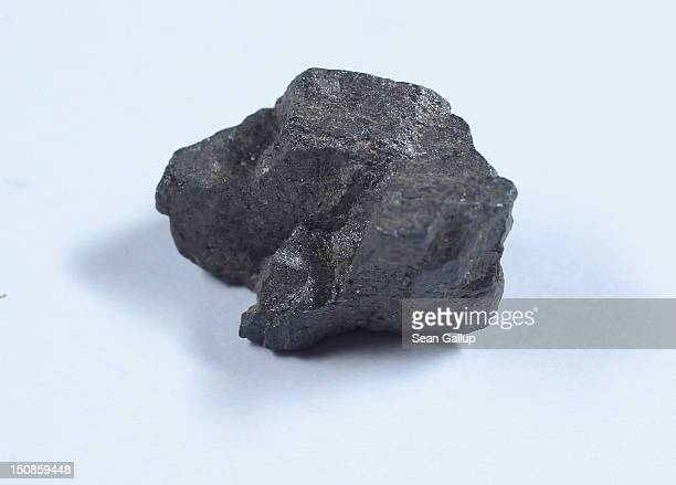 A chunk of tantalite ore from which tantalum a substance used in mobile phones is derived lies on a table at a press conference for a German...