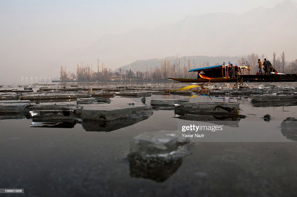 Chunks of ice float on the Dal Lake on a cold morning on January 3, 2013 in Srinagar, the summer capital of Indian administered Kashmir, India. Dal and other lakes often freeze during the harsh Kashmir winter as temperatures drop below freezing.