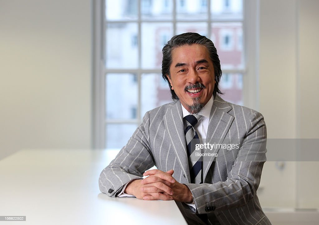 Chun-Kwan 'Sandy' Chim, president and chief executive officer of Century Iron Mines Corp., poses for a photograph in London, U.K., on Thursday, Nov. 22, 2012. Iron ore, trading at the most expensive level in almost four months, is set to stay near the highs until the end of the year on signs of improving growth in China as a new leadership takes over. Photographer: Chris Ratcliffe/Bloomberg via Getty Images