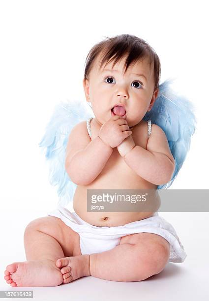 Chunky baby dressed in white angel costume