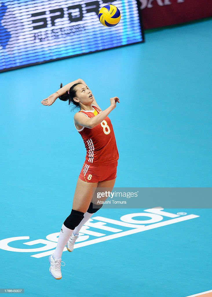 Chunlei Zeng of China serves the ball during day three of the FIVB World Grand Prix Sapporo 2013 match between China and USA at Hokkaido Prefectural Sports Center on August 30, 2013 in Sapporo, Hokkaido, Japan.
