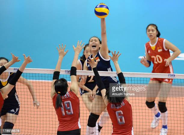 Chunlei Zeng of China spikes the ball during day four of the FIVB World Grand Prix Sapporo 2013 match between Japan and China at Hokkaido Prefectural...