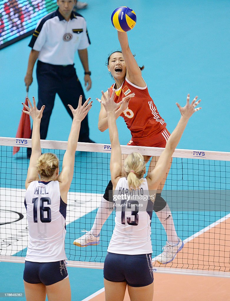 Chunlei Zeng of China spikes the ball during day three of the FIVB World Grand Prix Sapporo 2013 match between China and USA at Hokkaido Prefectural Sports Center on August 30, 2013 in Sapporo, Hokkaido, Japan.