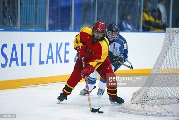 Chunrong Hu of China in possession against Olga Potapova of Kazakhstan during the game at the Salt Lake City Olympic Winter Games on February 19 2002...