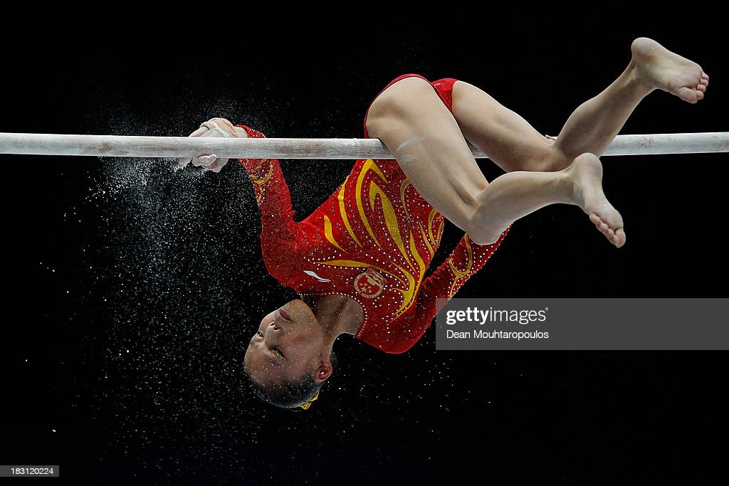 Chunsong Shang of China chalks the bar before she competes in the Uneven Bars during the Womens All-Round Final on Day Five of the Artistic Gymnastics World Championships Belgium 2013 held at the Antwerp Sports Palace on October 4, 2013 in Antwerpen, Belgium.