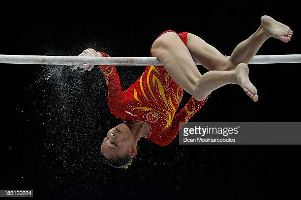 Chunsong Shang of China chalks the bar before she competes in the Uneven Bars during the Womens AllRound Final on Day Five of the Artistic Gymnastics...